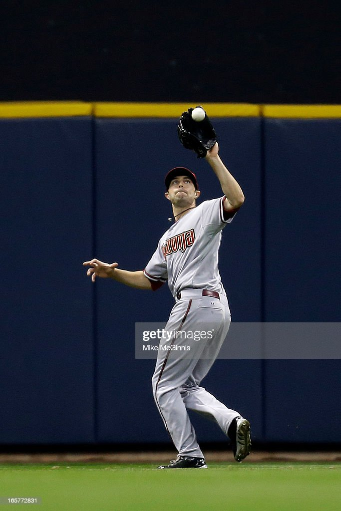 A.J. Pollock #11 of the Arizona Diamondbacks chases down a fly ball in center field off the bat of Kyle Lohse of the Milwaukee Brewers in the bottom of the fifth inning at Miller Park on April 5, 2013 in Milwaukee, Wisconsin.