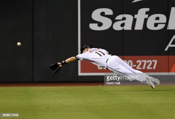 Pollock of the Arizona Diamondbacks dives for a ball in center field during the ninth inning against the Milwaukee Brewers at Chase Field on May 14...