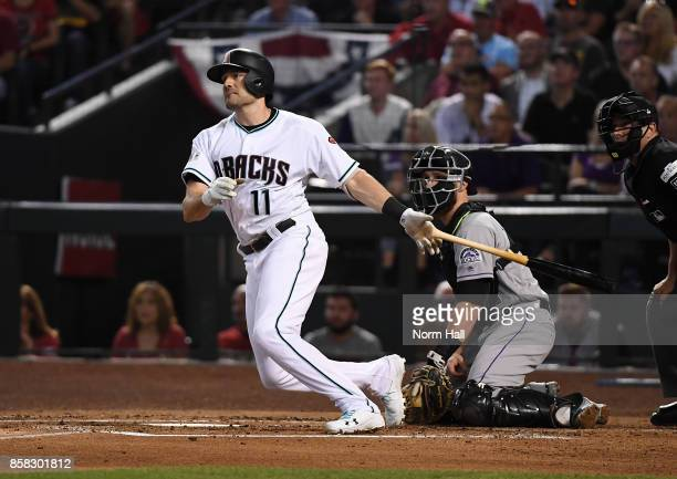 Pollock of the Arizona Diamondbacks follows through on a swing against the Colorado Rockies during the National League Wild Card Game at Chase Field...
