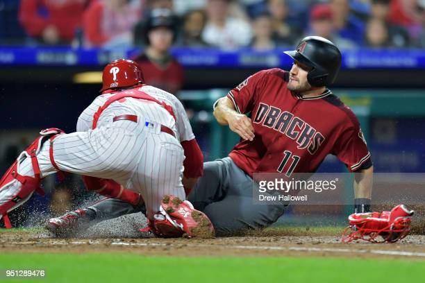 Pollock of the Arizona Diamondbacks gets put out at home by Andrew Knapp of the Philadelphia Phillies in the fourth inning at Citizens Bank Park on...