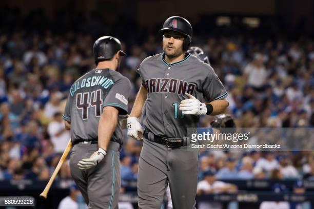 J Pollock of the Arizona Diamondbacks heads back to the dugout after hitting a home run during game one of the National League Division Series...