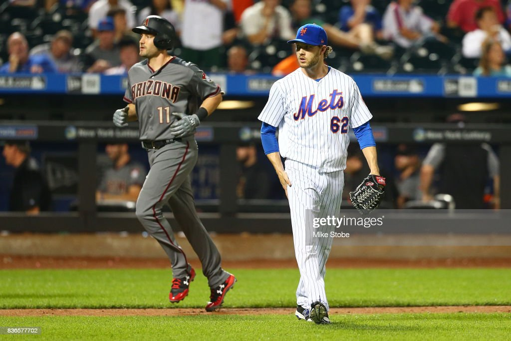 A.J. Pollock #11 of the Arizona Diamondbacks heads home after hitting a 2-run home run in the tenth inning as Erik Goeddel #62 of the New York Mets looks on at Citi Field on August 21, 2017 in the Flushing neighborhood of the Queens borough of New York City.