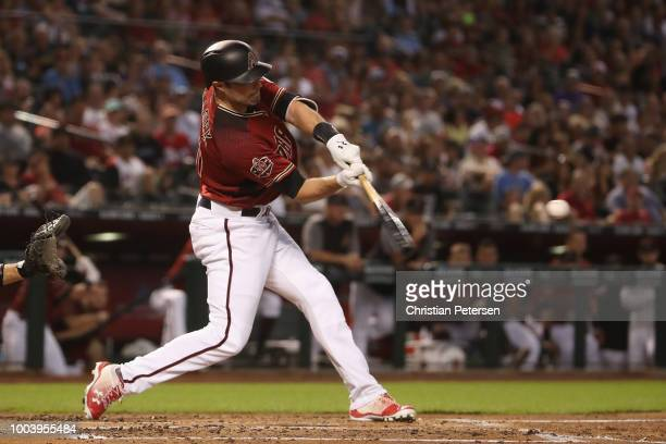 J Pollock of the Arizona Diamondbacks hits a double against the Colorado Rockies during the first inning of the MLB game at Chase Field on July 22...