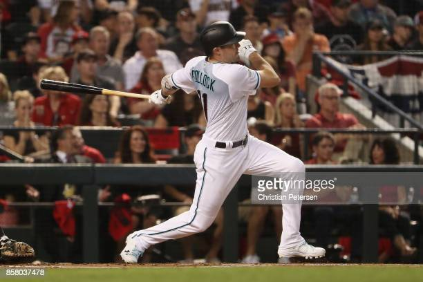 J Pollock of the Arizona Diamondbacks hits a double against the Colorado Rockies during the first inning of the National League Wild Card game at...