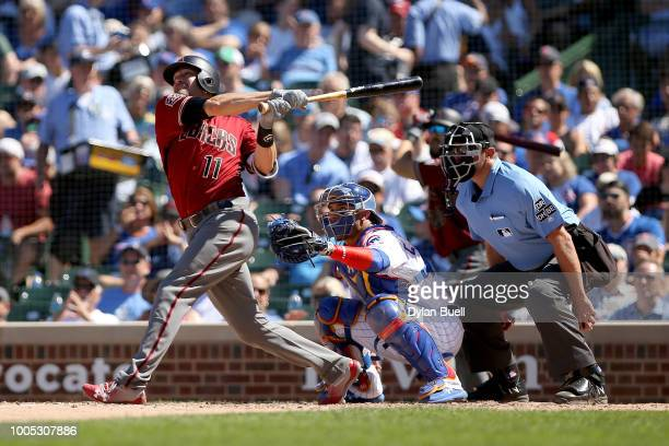 J Pollock of the Arizona Diamondbacks hits a home run in the seventh inning against the Chicago Cubs at Wrigley Field on July 25 2018 in Chicago...