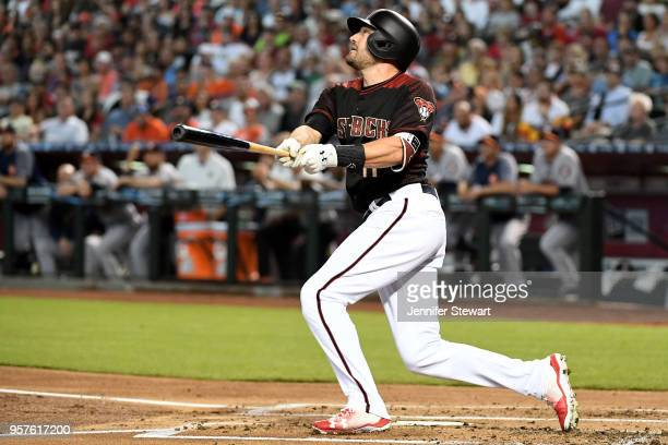 J Pollock of the Arizona Diamondbacks hits a sacrifice fly ball in the first inning of the MLB game against the Houston Astros at Chase Field on May...