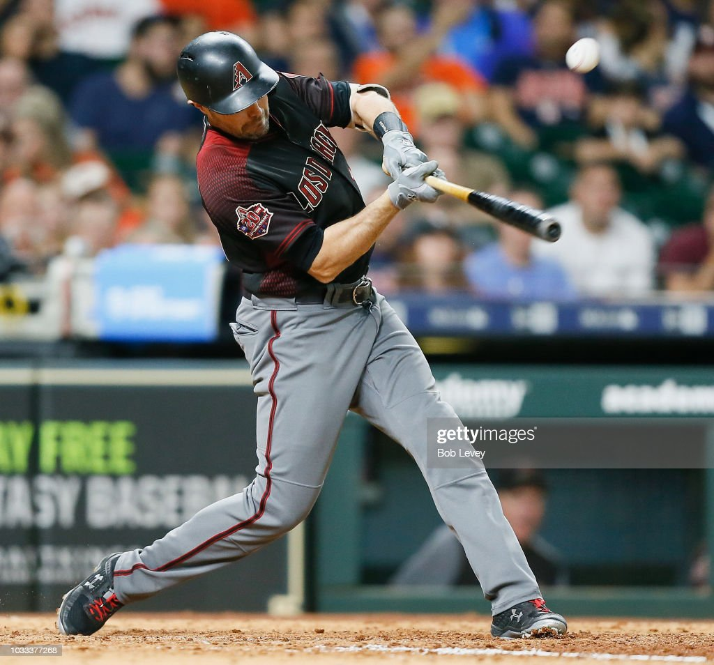 A.J. Pollock #11 of the Arizona Diamondbacks hits a single to center field in the eighth inning against the Houston Astros at Minute Maid Park on September 14, 2018 in Houston, Texas.
