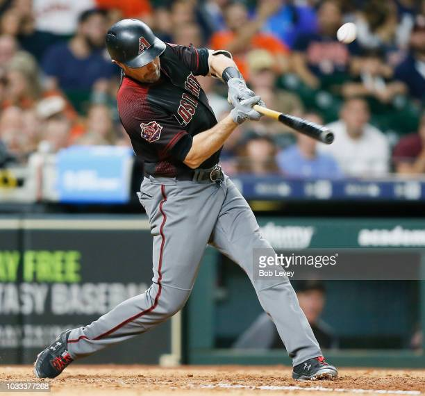 J Pollock of the Arizona Diamondbacks hits a single to center field in the eighth inning against the Houston Astros at Minute Maid Park on September...