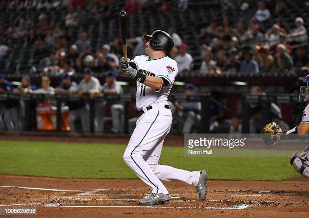 Pollock of the Arizona Diamondbacks hits a solo home run against the Texas Rangers during the first inning at Chase Field on July 31 2018 in Phoenix...