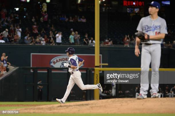 J Pollock of the Arizona Diamondbacks hits a two run home run against Kenta Maeda of the Los Angeles Dodgers in the third inning at Chase Field on...