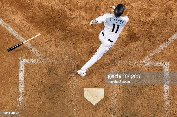J Pollock of the Arizona Diamondbacks hits a tworun triple in the eighth inning during the National League Wild Card against the Colorado Rockies at...