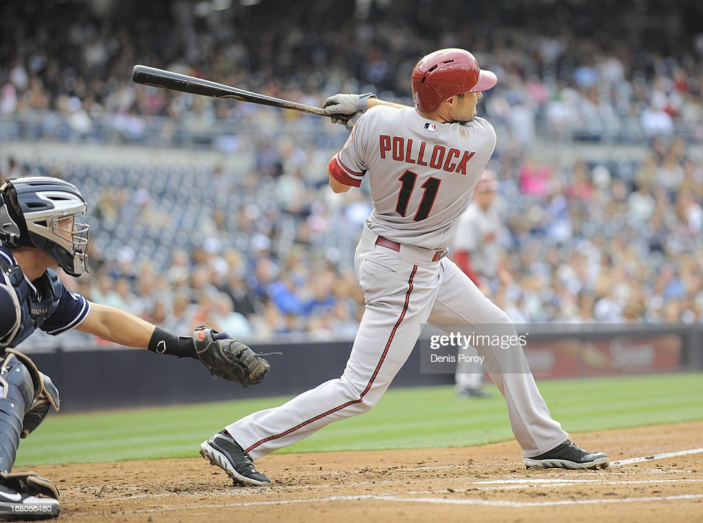 A.J. Pollock #11 of the Arizona Diamondbacks hits an RBI double during the second inning of a baseball game against the San Diego Padres at Petco Park on May 4, 2013 in San Diego, California.