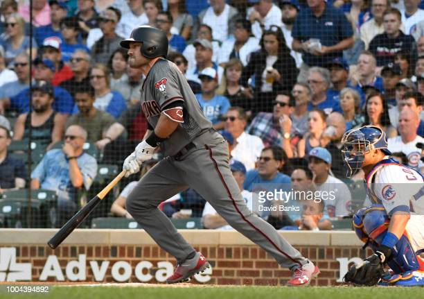 J Pollock of the Arizona Diamondbacks hits an RBI single against the Chicago Cubs during the first inning on July 23 2018 at Wrigley Field in Chicago...