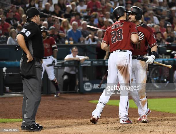 Pollock of the Arizona Diamondbacks is being held back by teammate Steven Souza Jr after being ejected for arguing balls and strikes with home plate...