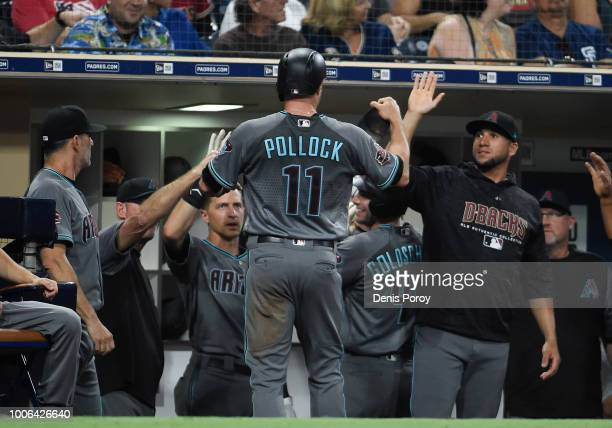 J Pollock of the Arizona Diamondbacks is congratulated after scoring during the third inning of a baseball game against the San Diego Padres PETCO...