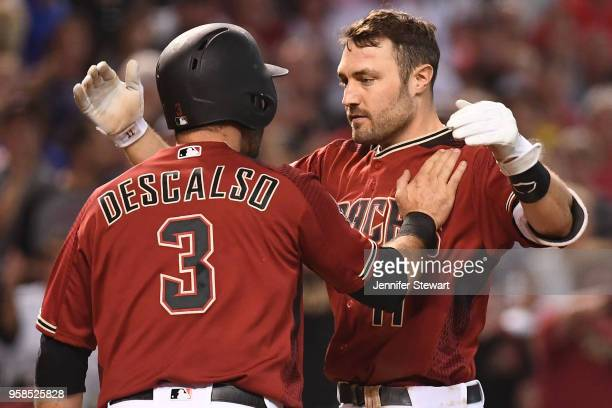 J Pollock of the Arizona Diamondbacks is congratulated by Daniel Descalso after scoring in the sixth inning of the MLB game against the Houston...