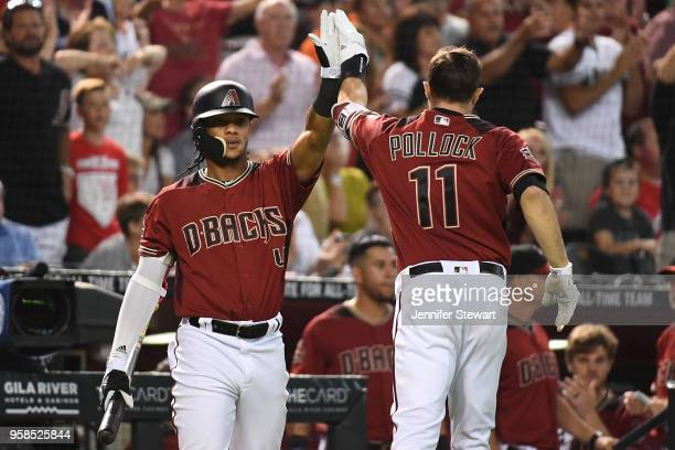 J Pollock of the Arizona Diamondbacks is congratulated by Ketel Marte after scoring in the sixth inning of the MLB game against the Houston Astros at...