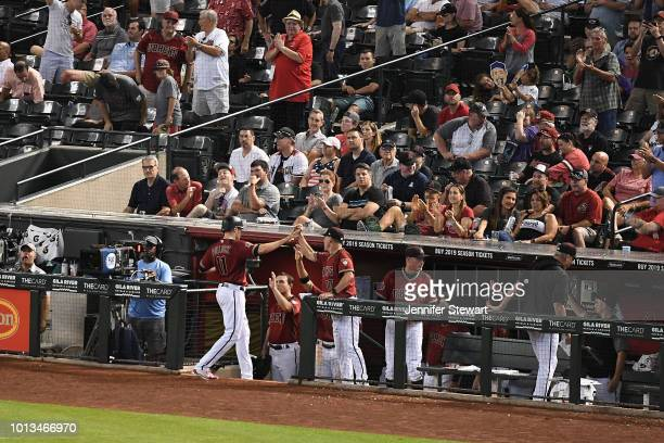 J Pollock of the Arizona Diamondbacks is congratulated by manager Torey Lovullo after scoring against the Philadelphia Phillies in the seventh inning...