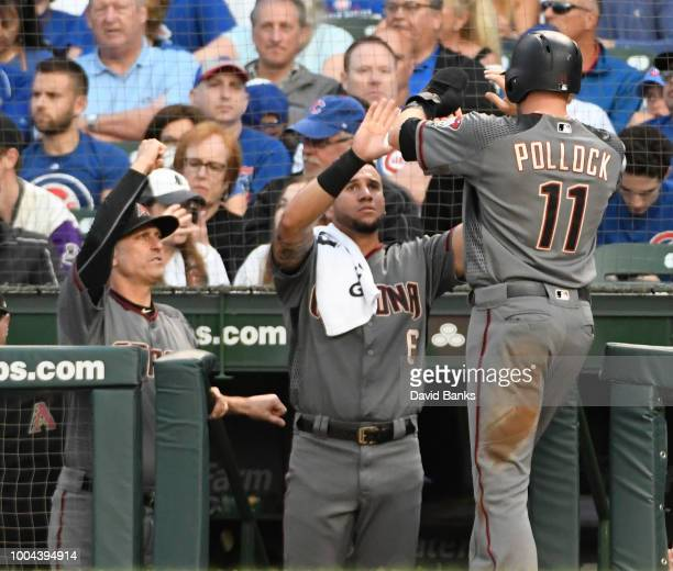 J Pollock of the Arizona Diamondbacks is greeted at the dugout after scoring against the Chicago Cubs during the first inning on July 23 2018 at...
