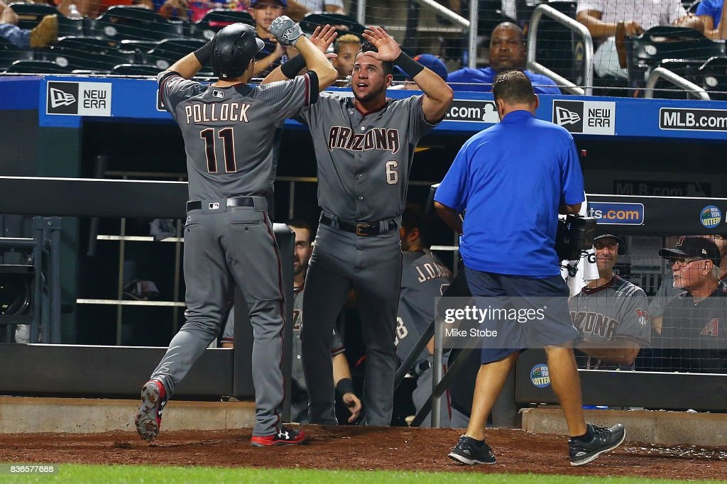 A.J. Pollock #11 of the Arizona Diamondbacks is greeted by David Peralta #6 after hitting a 2-run home run in the tenth inning against the New York Mets at Citi Field on August 21, 2017 in the Flushing neighborhood of the Queens borough of New York City.