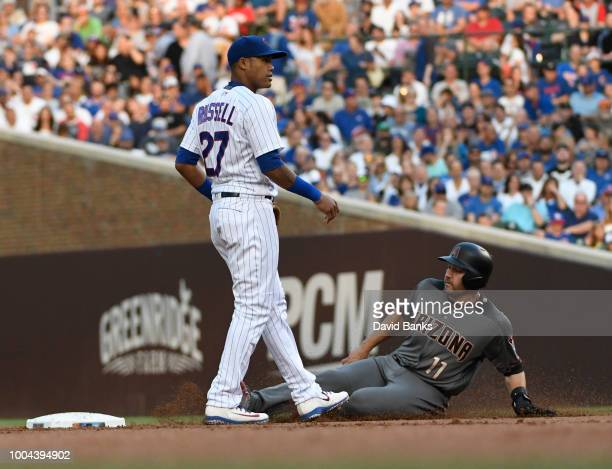 J Pollock of the Arizona Diamondbacks is safe at second base as Addison Russell of the Chicago Cubs covers the base during the first inning on July...