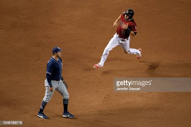 J Pollock of the Arizona Diamondbacks is safe at third after a throwing error in the fourth inning of the MLB game against the San Diego Padres at...