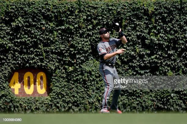 J Pollock of the Arizona Diamondbacks makes a catch for an out on a fly ball hit by Ian Happ of the Chicago Cubs during the second inning at Wrigley...