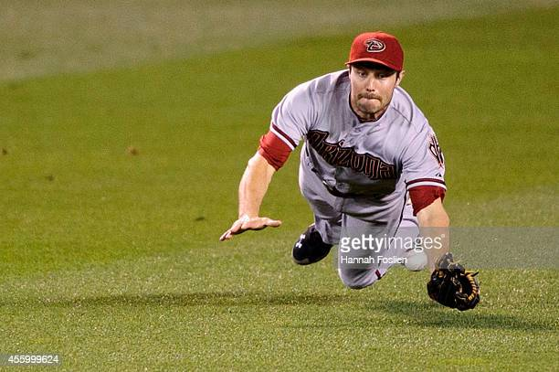 Pollock of the Arizona Diamondbacks misses a ball off the bat of Eduardo Nunez of the Minnesota Twins that went for a double in the fourth inning of...