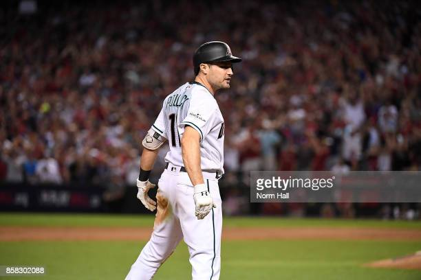 Pollock of the Arizona Diamondbacks reacts after hitting a triple in the eighth inning against the Colorado Rockies during the National League Wild...
