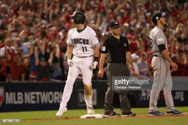 J Pollock of the Arizona Diamondbacks reacts after hitting a triple during the bottom of the eighth inning of the National League Wild Card game...