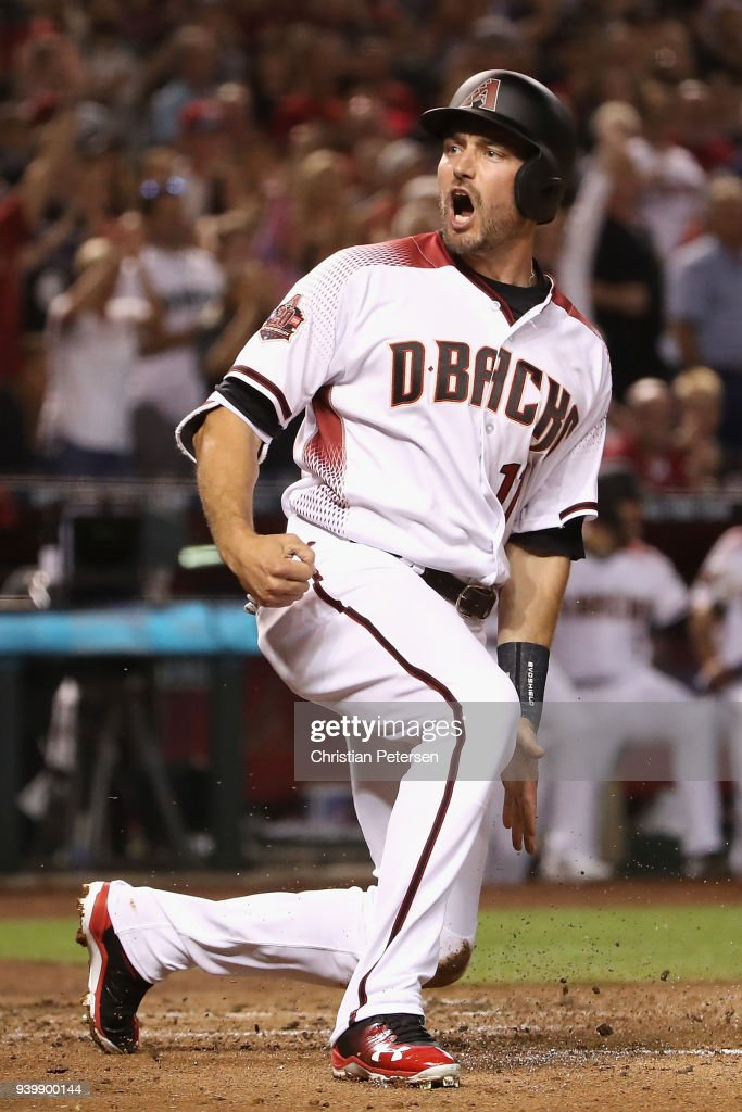 A.J. Pollock #11 of the Arizona Diamondbacks reacts after scoring against the Colorado Rockies during the first inning of the opening day MLB game at Chase Field on March 29, 2018 in Phoenix, Arizona.