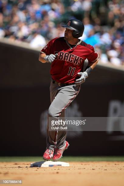 J Pollock of the Arizona Diamondbacks rounds the bases after hitting a home run in the seventh inning against the Chicago Cubs at Wrigley Field on...