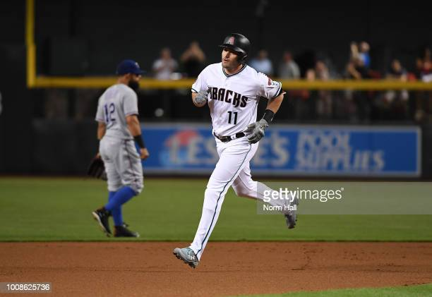 Pollock of the Arizona Diamondbacks rounds the bases after hitting a solo home run against the Texas Rangers during the first inning at Chase Field...