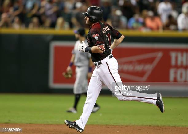 J Pollock of the Arizona Diamondbacks rounds the bases after hitting a home run against the Colorado Rockies during the fifth inning of an MLB game...