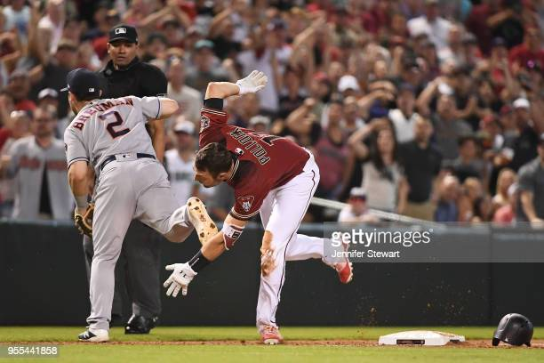 J Pollock of the Arizona Diamondbacks runs home to score on an interference error by Alex Bregman of the Houston Astros in the sixth inning of the...