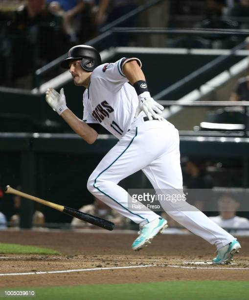 J Pollock of the Arizona Diamondbacks runs to first after hitting a single against the Colorado Rockies during the first inning of an MLB game at...
