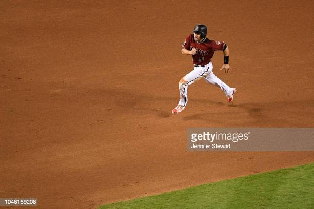 J Pollock of the Arizona Diamondbacks runs to third base during the fourth inning of the MLB game against the San Diego Padres at Chase Field on...