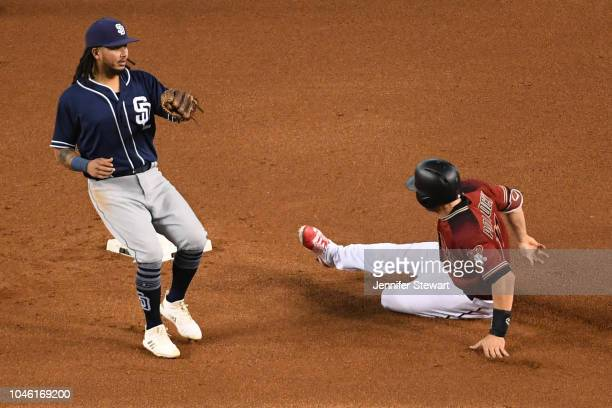 J Pollock of the Arizona Diamondbacks safely steals second base in front of Freddy Galvis of the San Diego Padres in the fourth inning of the MLB...