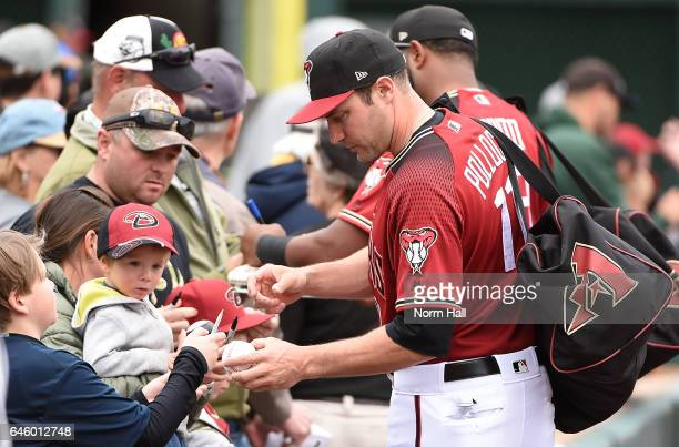 Pollock of the Arizona Diamondbacks signs autographs prior to a game against the Cincinnati Reds at Salt River Fields at Talking Stick on February 27...