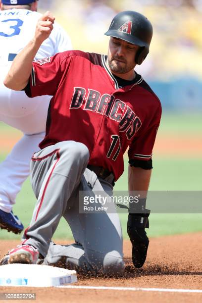 J Pollock of the Arizona Diamondbacks slides into first during the game against the Los Angeles Dodgers at Dodger Stadium on Sunday September 2 2018...