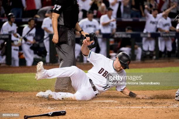 J Pollock of the Arizona Diamondbacks slides into home during the National League Wild Card Game against the Colorado Rockies at Chase Field on...