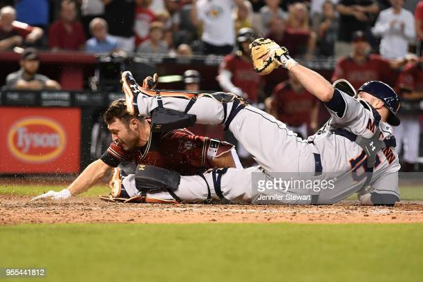 J Pollock of the Arizona Diamondbacks slides into home plate against Brian McCann of the Houston Astros to score on an interference error by Alex...