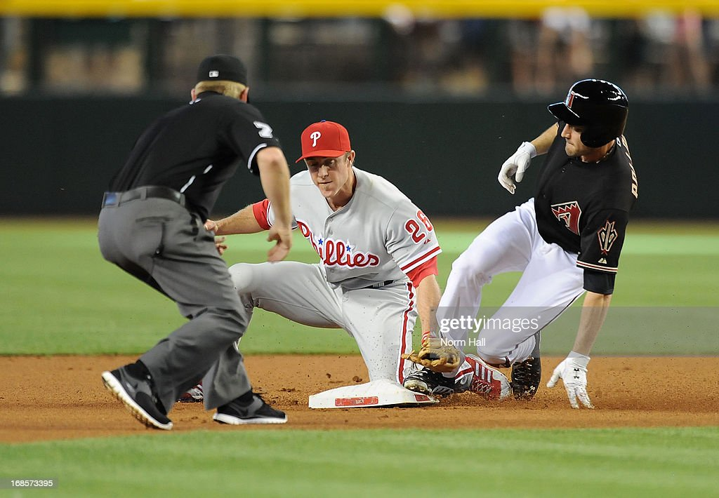 AJ Pollock #11 of the Arizona Diamondbacks slides into second base safely just ahead of the tag by Chase Utley #26 of the Philadelphia Phillies at Chase Field on May 11, 2013 in Phoenix, Arizona.