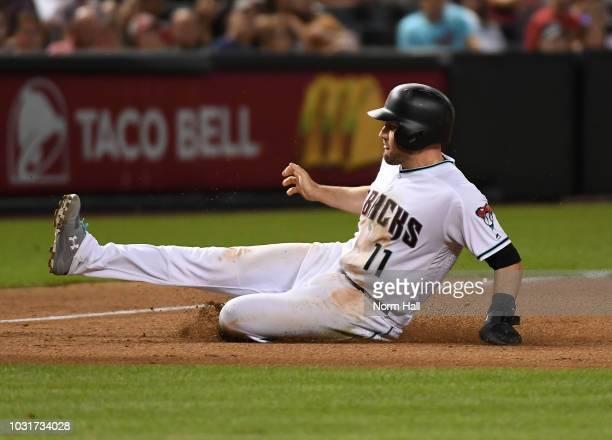 Pollock of the Arizona Diamondbacks slides into third base against the San Diego Padres at Chase Field on September 4 2018 in Phoenix Arizona