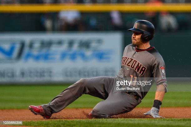 J Pollock of the Arizona Diamondbacks slides into third base with a first inning triple against the Colorado Rockies at Coors Field on September 10...