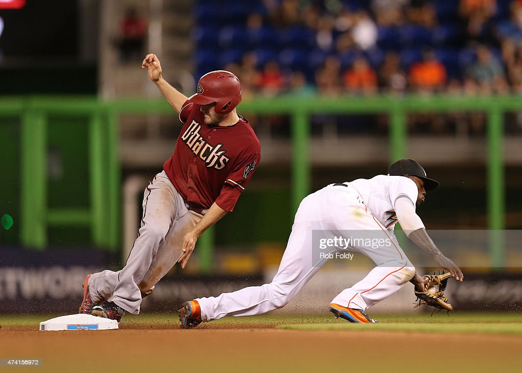 A.J. Pollock #11 of the Arizona Diamondbacks steals second base during the seventh inning of the game against the Miami Marlins at Marlins Park on May 20, 2015 in Miami, Florida.