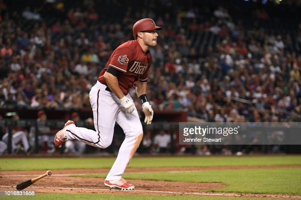 J Pollock of the Arizona Diamondbacks swings at a pitch in the MLB game against the San Francisco Giants at Chase Field on August 2 2018 in Phoenix...