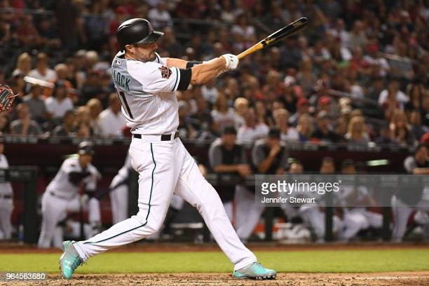 J Pollock of the Arizona Diamondbacks swings at a pitch in the ninth inning of the MLB game against the Washington Nationals at Chase Field on May 11...
