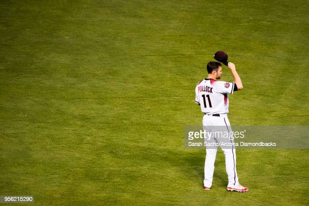 J Pollock of the Arizona Diamondbacks tips his cap while being recognized as April's National League Player of the Month during a game against the...
