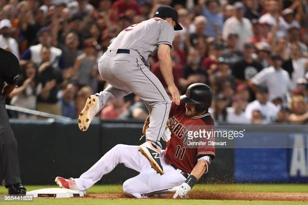 J Pollock of the Arizona Diamondbacks triples in the sixth inning of the MLB game against Alex Bregman of the Houston Astros at Chase Field on May 6...